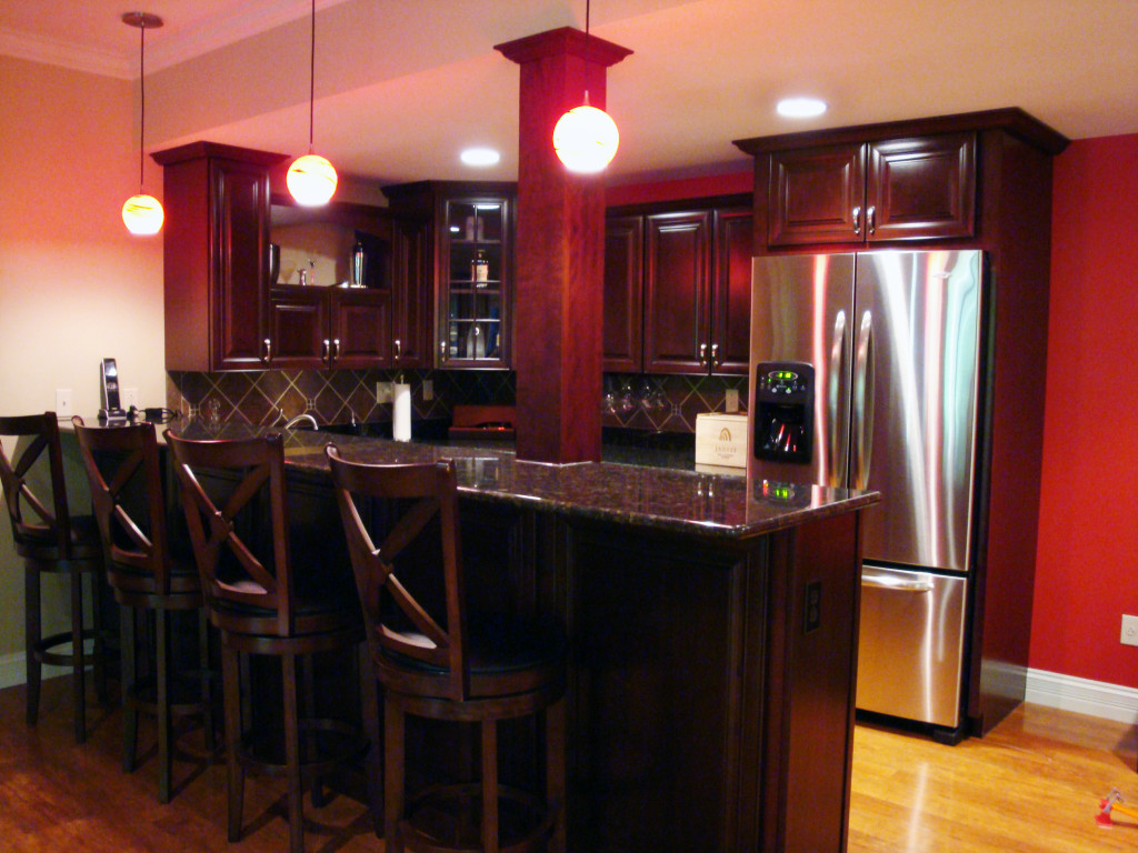 Basement Bar Featuring KraftMaid Cabinetry In Cherry Cabernet With Granite  Countertops